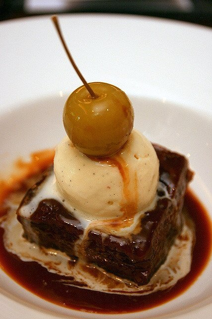 Steamed Toffee and Date Pudding with toffee sauce and vanilla ice cream